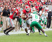 The Georgia Bulldogs played North Texas Mean Green at Sanford Stadium.  After North Texas tied the game at 21 early in the second half, the Georgia Bulldogs went on to score 24 unanswered points to win 45-21.  Georgia Bulldogs tight end Arthur Lynch (88), North Texas Mean Green defensive back Marcus Trice (8)