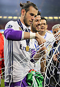 June 3rd 2017, National Stadium of Wales , Wales; UEFA Champions League Final, Juventus FC versus Real Madrid; Gareth Bale of Real Madrid cuts the net as a souvenier  after their 4-1 win