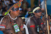 "Altamira, Brazil. ""Xingu Vivo Para Sempre"" protest meeting about the proposed Belo Monte hydroeletric dam and other dams on the Xingu river and its tributaries. Yudja chief  Yapariwa listens to the presentation."