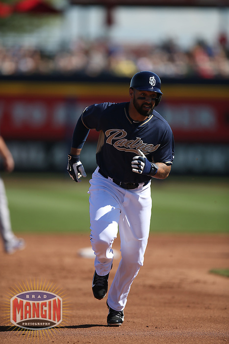 PEORIA, AZ - MARCH 8:  Matt Kemp of the San Diego Padres runs the bases against the Colorado Rockies during a spring training game at the Peoria Sports Complex on March 8, 2015 in Peoria, Arizona. (Photo by Brad Mangin)