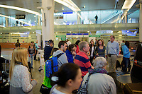 People wait at baggage claim at Sheremetyevo International Airport in Khimki, Moscow, Moskovskii Oblast, Russia.