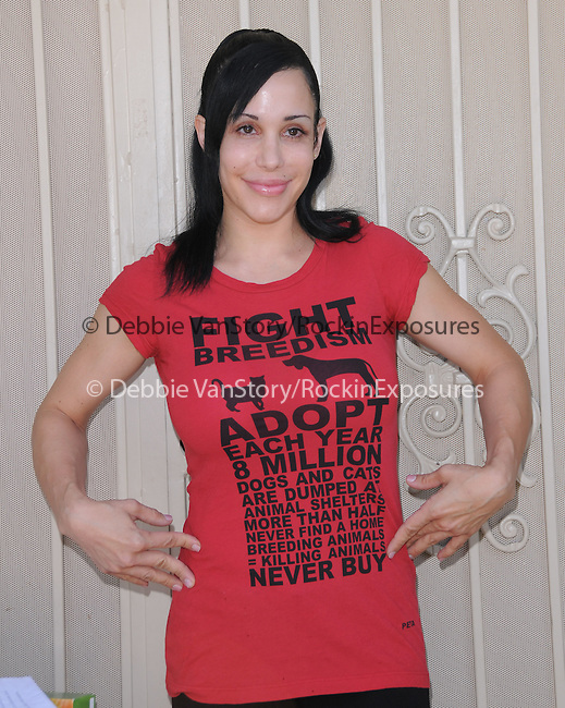 """Nadya Suleman the Famous Mother of Octuplets Accepts PETA's Offer to Help Her Keep Her House by Promoting Spaying and Neutering & unveiling a poster stating """"Don't Let Your Dog or Cat Become an 'Octomom'--Always Spay or Neuter"""" held at Nadya's home in La Habra, California on May 19,2010                                                                   Copyright 2010  DVS / RockinExposures"""