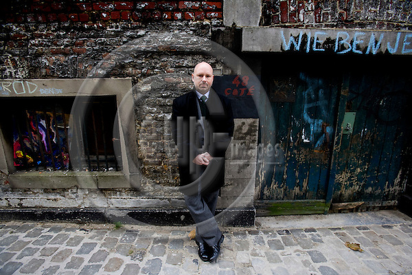 BRUSSELS - BELGIUM - 17 NOVEMBER 2008 -- Søren (Soeren, Soren) Hyldstrup LARSEN, Director EU Affairs at Danish Transport and Logistics Association (DTL).  Her standing under the dutch graffiti text, Wie ben je?, which means: Who are you?  Photo: Erik Luntang/EUP-IMAGES