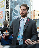 Mike Moran (BU - 11) - The teams walked the red carpet through the Fan Fest outside TD Garden prior to the Frozen Four final on Saturday, April 11, 2015, in Boston, Massachusetts.