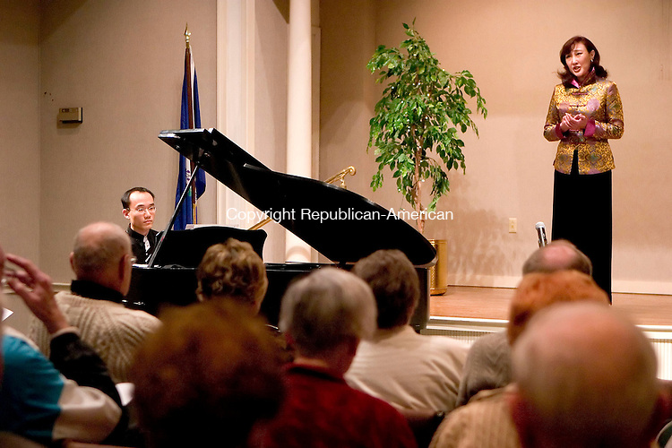 SOUTHBURY, CT- 15 APRIL 07- 041507JT05- <br /> Pianist Jian Liu, a graduate student at Yale School of Music, plays a Chinese folk song accompanied by soprano Ming Yuan at Pomperaug Woods in Southbury on Sunday. Liu also performed pieces by Brahms, Bach, Mozart and Schumann.<br /> Josalee Thrift Republican-American