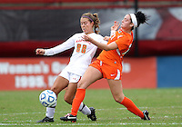 COLLEGE PARK, MD - OCTOBER 28, 2012:  Aubrey Baker (3) of the University of Maryland tackles Ally Andreini (27)  of Miami during an ACC  women's tournament 1st. round match at Ludwig Field in College Park, MD. on October 28. Maryland won 2-1 on a golden goal in extra time.
