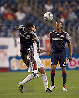 New England Revolution defender Emmanuel Osei (5) heads away pass to DC United forward Pablo Hernandez (21). The New England Revolution defeated DC United, 1-0, at Gillette Stadium on August 7, 2010.