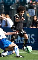 SANTA CLARA, CA--Eriko Arakawa gets the ball past a defender during the 1-0 loss to the Boston Breakers.  Sunday, July 19, 2009.