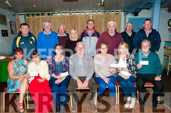 Kilflynn Vintage Club Cheque Presentations: Joe Brennan, centre front, chairman of Killflynn vintage club presenting cheque to the Tina McElligott Treatment Club, Down Syndrome Kerry, St. Theresa's NS & the Kilfynn Defibrillator Group at Parkers Pub, Kilflynn on Friday night last.
