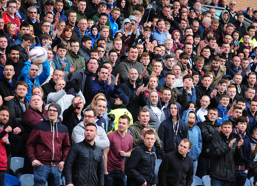 Burnley fans during the first half<br /> <br /> Photo by Chris Vaughan/CameraSport<br /> <br /> Football - The Football League Sky Bet Championship - Burnley v Middlesbrough - Saturday 12th April 2014 - Turf Moor - Burnley<br /> <br /> &copy; CameraSport - 43 Linden Ave. Countesthorpe. Leicester. England. LE8 5PG - Tel: +44 (0) 116 277 4147 - admin@camerasport.com - www.camerasport.com