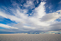 Bolivia, Altiplano, interesting cloud formations above Salar de Uyuni, world's largest salt pan