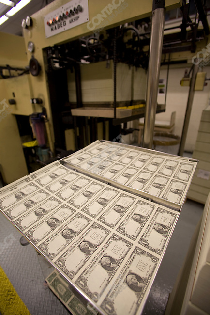 Printing, cutting, etc. $1 and $100 bills, in sheets, then cutting to bills size at the Bureau of Engraving and Printing. Washington D.C. September 24 2008..