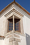Window balcony and architectural detail of building inside historic walled hilltop village of Monsaraz, Alto Alentejo, Portugal, southern Europe