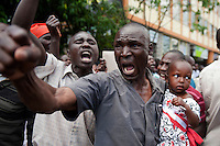 Independent Electoral and Boundaries Commission (IEBC) declared Uhuru Kenyatta as the winner of the presidential contest on 9 March 3013, after the failure of the electronic results transmission system delayed the process. Kenyatta's opponent, Raila Odinga, has contested the IEBC results alleging fraud and voter intimidation. Here, a supporter of Raila Odinga protests in front of the Supreme Court in downtown Nairobi on 11 March 2013. .JENNIFER HUXTA / AGENCE FRANCE PRESSE/ GETTY IMAGES
