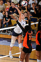 10 September 2009:  FIU's Yarimar Rosa (3) hits a kill shot in the third set as FIU defeated the University of Miami Hurricanes in straight sets, 3-0 (26-24, 26-24, 25-17) at U.S. Century Bank Arena in Miami, Florida.