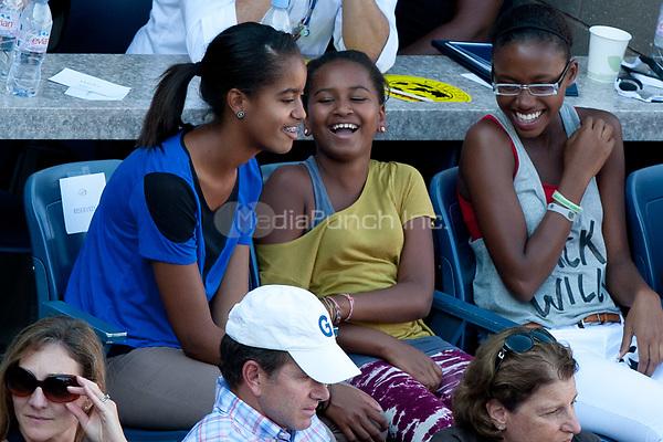 NEW YORK, NY - SEPTEMBER 09: First Lady Michelle Obama attends the 2011 US Open at USTA Billie Jean King National Tennis Center on September 9, 2011 in New York City<br /> <br /> <br /> People:  Malia Obama_Sasha Obama<br /> <br /> Transmission Ref:  MNC<br /> <br /> Hoo-Me.com / MediaPunch