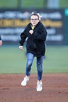 A young fan runs the bases in the mascot race between innings of the South Atlantic League game between the Lakewood BlueClaws and the Kannapolis Intimidators at Kannapolis Intimidators Stadium on April 6, 2017 in Kannapolis, North Carolina.  The BlueClaws defeated the Intimidators 7-5.  (Brian Westerholt/Four Seam Images)