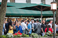 The after work crowd mobs the Bryant Park Grill in Bryant Park in New York on a warm evening on Thursday, May 31, 2012. (© Richard B. Levine)