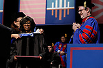 Labor and employment attorney Paulette Brown, commencement speaker, is given an honorary degree by Jennifer Rosato Perea, dean of the College of Law, as the Rev. Dennis H. Holtschneider, C.M., president of DePaul, looks on during the College of Law commencement ceremony, Sunday, May 14, 2017. The ceremony was held at the Rosemont Theatre in Rosemont, IL, where some 240 students received their Juris Doctors or Master of Laws degrees. (DePaul University/Jeff Carrion)