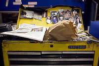 A copy of the Colbrook Chronicle featuring Newt Gingrich rests on a toolbox at a Romney campaign event to begin at Gilchrist Metal Fabricating in Hudson, New Hampshire, on Jan. 9, 2012.  Romney is seeking the 2012 Republican presidential nomination.