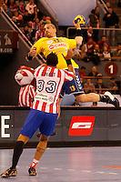 28.04.2012 MADRID, SPAIN -  EHF Champions League match played between BM At. Madrid vs  Cimos Koper (31-24) at Palacio Vistalegre stadium. The picture show Milorad Krivokapic (Center of Cimos Koper) and Didier Dinart (BM Atletico de Madrid)