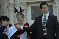 "Singer Johnny Hochgraefe listens as members of the audience sing parts of the chorus to ""The Twelve Days of Christmas"" during the Annual Christmas Sing-Along at the Spreckels Organ Pavillion in Balboa Park on Sunday December 23, 2007."