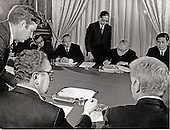 Paris, France - (FILE) -- Ambassador William H. Sullivan (lower right) and Xuan Thuy (upper right) watch as Dr. Henry Kissinger (lower center) and Le Duc Tho (second from upper right) initial the Paris Peace Accords in Paris on Tuesday, January 23, 1973.<br /> Credit: White House via CNP
