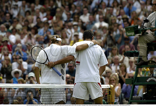 Winner ROGER FEDERER (SUI) and MARK PHILIPPOUSSIS (AUS) with their arms around each other after the Men's Singles Final, 2003 Wimbledon Lawn Tennis Championships, 030706. Photo: Glyn Kirk/Action Plus...2003 player players men man.sportsmanship consolation congratulation