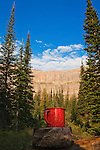 A red tin cup and the Chinese Wall in Montana's Bob Marshall Wilderness