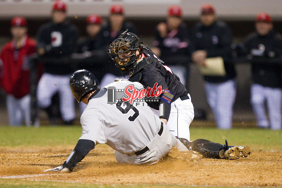 Davidson Wildcats catcher Chris Dyer (19) tags out Ben Breazeale (9) of the Wake Forest Demon Deacons as he tries to score a run at Wilson Field on March 19, 2014 in Davidson, North Carolina.  The Wildcats defeated the Demon Deacons 7-6.  (Brian Westerholt/Sports On Film)