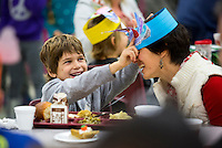 NWA Democrat-Gazette/JASON IVESTER <br /> Braeden (cq) Hall, Bellview Elementary kindergartner, slides his hat onto his mother, Sherrie (cq) Hall, on Thursday, Nov. 19, 2015, at the Rogers school. According to principal Dan Cox, the school sold about 600 tickets for their annual Thanksgiving meal.