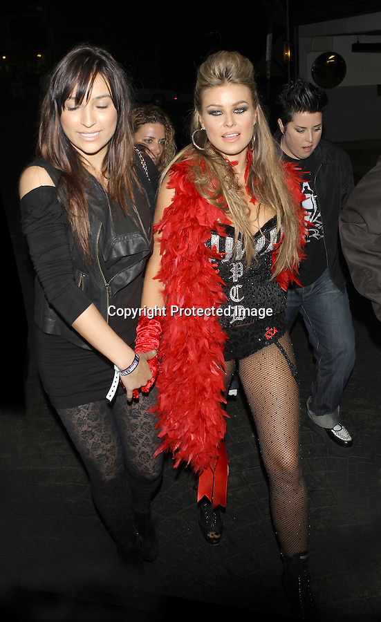 .Septemeber 1st 2010  Wed night ..Carmen Electra leaving The Viper Room in Hollywood & going to the London Hotel. Carmen was wearing a black & silver bustier bra & lingerie showing off her cleavage. Carmen looked really hot wearing her net black tights red gloves & feather boa ..AbilityFilms@yahoo.com.805-427-3519.www.AbilityFilms.com.