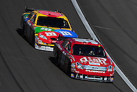 Mar 2, 2008; Las Vegas, NV, USA; NASCAR Sprint Cup Series driver Carl Edwards (99) leads Kyle Busch (18) during the UAW Dodge 400 at Las Vegas Motor Speedway. Mandatory Credit: Mark J. Rebilas-US PRESSWIRE