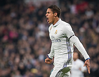 Real Madrid's French defense Raphael Varane celebrating after scoring during the Copa del Rey soccer match between Real Madrid and Sevilla played at the Santiago Bernabéu stadium in Madrid, on January 4th 2017.