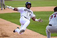 Kane County Cougars third baseman Luis Lara (8) slides into third base during a Midwest League game against the Quad Cities River Bandits on July 1, 2018 at Northwestern Medicine Field in Geneva, Illinois. Quad Cities defeated Kane County 3-2. (Brad Krause/Four Seam Images)