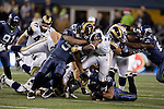 St. Louis Rams running back Steven Jackson is brought down after a short gain by Seattle Seahawks linebackers Leroy Hill (56) and David Hawthorne (57) at  CenturyLink Field in Seattle, Washington on December 12, 2011. The Seahawks beat the Rams 30-13. ©2011 Jim Bryant Photo. All Rights Reserved.