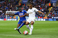 Wayne Routledge of Swansea City and Jeff Schlupp of Leicester City in action during the Barclays Premier League match between Leicester City and Swansea City played at The King Power Stadium, Leicester on 24th April 2016