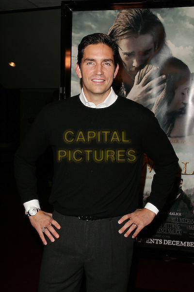 "JIM CAVIEZEL.""The New World"" Los Angeles Premiere to Benefit the American Film Institute held at the Academy of Motion Pictures Arts and Sciences, Beverly Hills, California. .December 15th, 2005.Photo: William Scott/AdMedia/Capital Pictures.half length hands on hips black jumper.www.capitalpictures.com.sales@capitalpictures.com.© Capital Pictures."