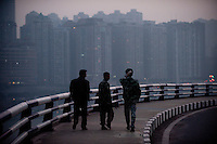 Men Walking On A Commercial Road Overlooking The CBD Cityscape In Chongqing, China.  © LAN