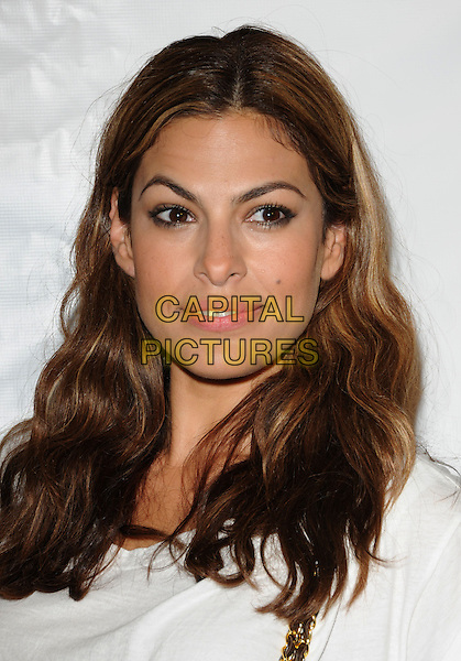 EVA MENDES.at the Los Angeles Nomadic Division 1st Annual Benefit held at The Sunset Tower Hotel in West Hollywood, California, USA, July 15th 2010                                                                               portrait headshot wavy hair cream white .CAP/RKE/DVS.©DVS/RockinExposures/Capital Pictures.