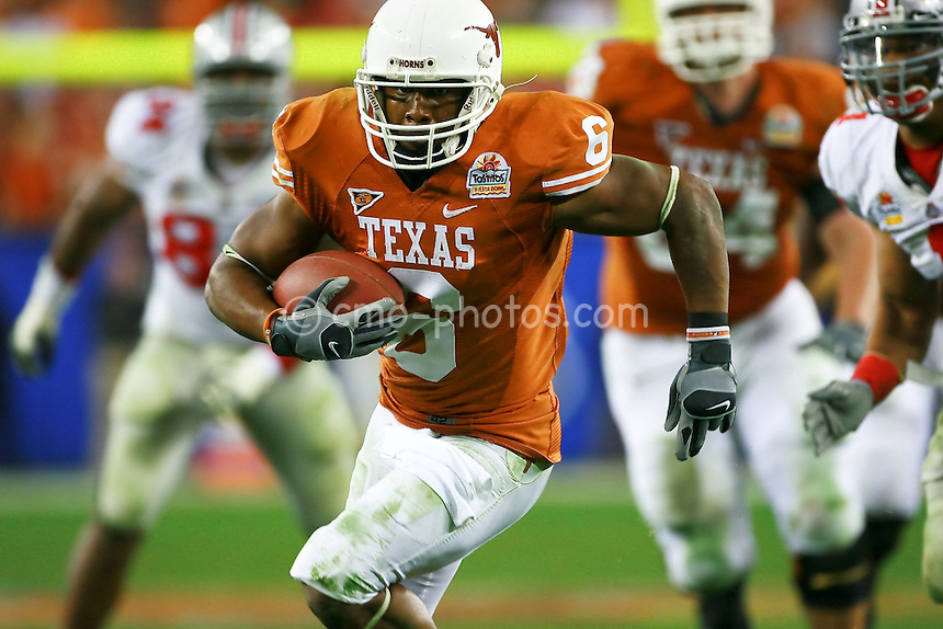 Jan 05, 2009; Glendale, AZ, USA; Texas Longhorns wide receiver Quan Cosby (6) runs in for the game-winning touchdown in the fourth quarter of the Fiesta Bowl against the Ohio State Buckeyes at University of Phoenix Stadium.  The Longhorns won the game 24-21.