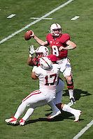 STANFORD, CA- April 13, 2013- The Stanford Cardinal and Whites Spring Game. Kevin Hogan makes a pass while A.J. Tarpley makes a block during the Cardinal and White spring game. <br /> <br /> isiphotos.com