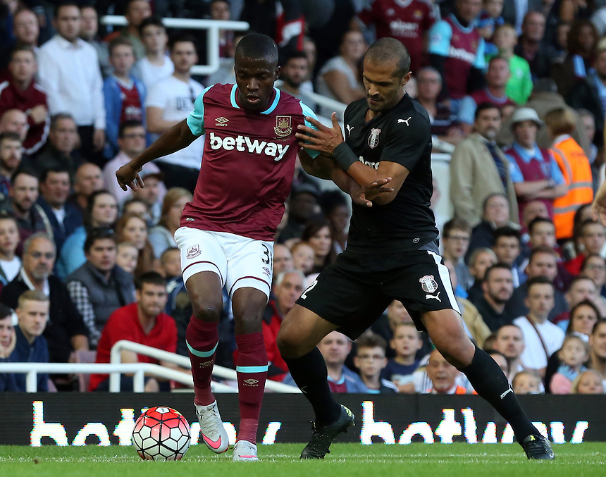 West Ham United's Enner Valencia despite the attentions of  FC Astra Giurgiu Geraldo Alves<br /> <br /> Photographer Kieran Galvin/CameraSport<br /> <br /> Football - UEFA Europa League Qualifying Third Round First Leg - West Ham United v Astra Giurgiu - Thursday 30 July 2015 - Boleyn Ground - London<br /> <br /> &copy; CameraSport - 43 Linden Ave. Countesthorpe. Leicester. England. LE8 5PG - Tel: +44 (0) 116 277 4147 - admin@camerasport.com - www.camerasport.com