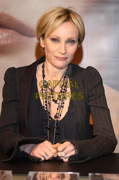 PATRICIA KAAS.Signing autographs, Karstadt, Hamburg, Germany. .February 12th, 2009.half length black brown blue top jacket necklaces .CAP/PPG/compb.©People Picture/Capital Pictures