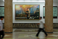 "A painting featuring ""Dear Leader"" Kim Jong-il inside the People's Palace of Education, Pyongyang, North Korea. The ""Palace"" is the library and place of learning for privileged North Koreans."