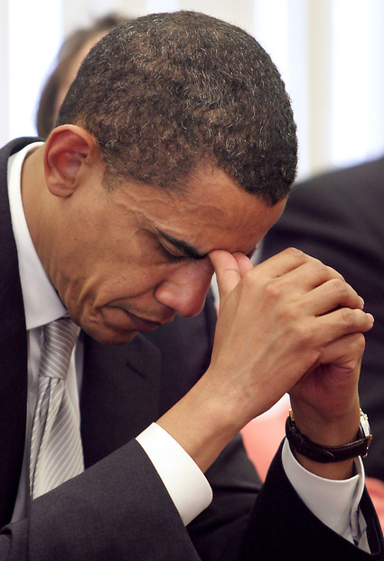 Sen. Barack Obama bows his head before delivering a speech to supporters April 21, 2007 in Johnton, Iowa.