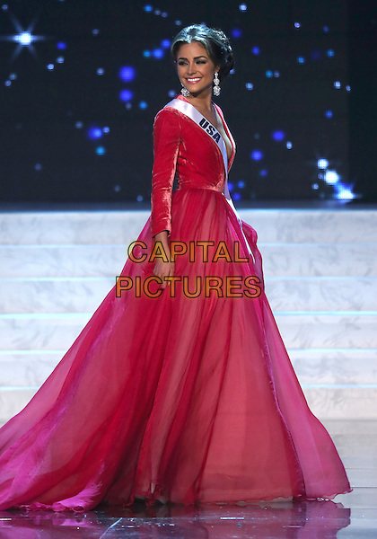 Miss Universe Olivia Culpo.Miss USA Olivia Culpo named Miss Universe 2012 at Planet Hollywood Resort and Casino, Preliminary Competition, Las Vegas, NV., USA.  .December 19th, 2012.full length on stage red dress gown velvet skirt sash.CAP/ADM/MJT.© MJT/AdMedia/Capital Pictures.