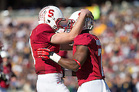 Stanford, CA -- November 23, 2013:  Stanford's Kevin Hogan celebrates with Ty Montgomery after a touchdown reception during a game against Cal at Stanford Stadium. Stanford defeated Cal 63-13.