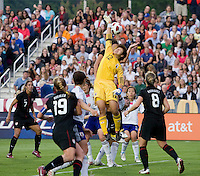 Abby Wambach (20) of the USWNT has the ball cleared away from her by Ayumi Kaihori (12) of Japan during the game at WakeMed Soccer Park in Cary, NC.   The USWNT defeated Japan, 2-0..