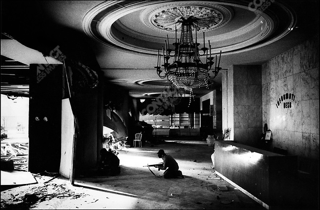 Christian gunmen shooting from the destroyed lobby of the Holiday Inn hotel against Palestinians, Beirut, Lebanon, January - February, 1976